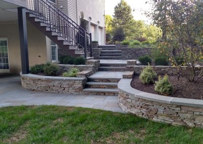 Steps from driveway down to patio